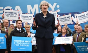Prime Minister Theresa May speaks to party supporters in front of the Conservative party's battlebus.