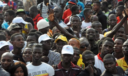 "Crowds cheer during the ""Bye bye, Au revoir Ebola"" (Bye bye, Goodbye Ebola) concert in December, celebrating the end of the disease in Guinea"