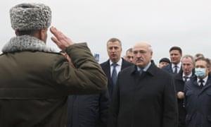 President Alexander Lukashenko taking a soldier's salute.