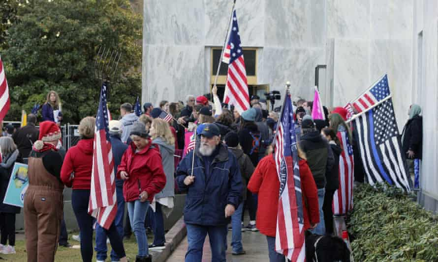 Pro-Trump and anti-mask demonstrators hold a rally outside the Oregon state capitol as legislators meet for an emergency session in Salem, Oregon, on 21 December 2020.