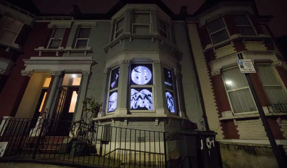 A house in north London with decorated windows as part of South Harringay school's ADVENTure trail.