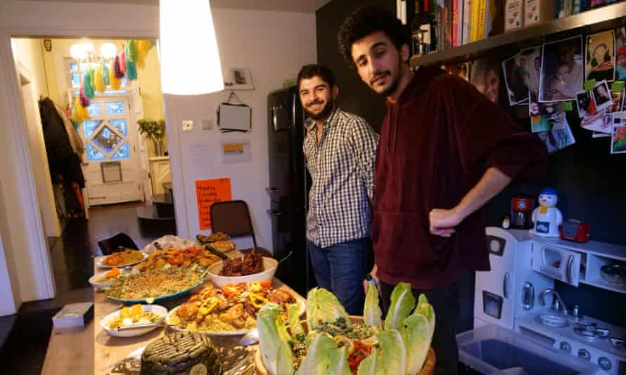 Mo Rahimeh (left) and Mohamad Aljasem with the Syrian food for their Christmas with Peter Hanington and his family.