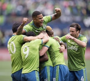 Teammates mob Seattle Sounders defender Kelvin Leerdam, obscured at center, after his goal against Toronto FC during the second half of the MLS Cup soccer match in Seattle on Sunday, Nov. 10, 2019. (Jonathan Hayward/The Canadian Press via AP)