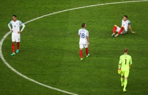 Gary Cahill drops to the floor as the England players show their frustration at the final whistle.