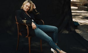 Robin Wright, in jeans and a blazer, sitting