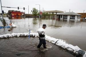 James Fontenoy, of Davenport, helps sandbag a house after a flood wall on the Mississippi river broke.