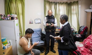 Newham housing officer Dawn Davis and police interview a man who collected rent for the landlord from other tenants in an unlicensed property with multiple occupants..