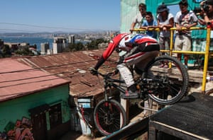 A cyclist competes in the Valparaiso downhill race with 40 professional cyclists taking part in the competition among the houses and streets on a hill in the historic city