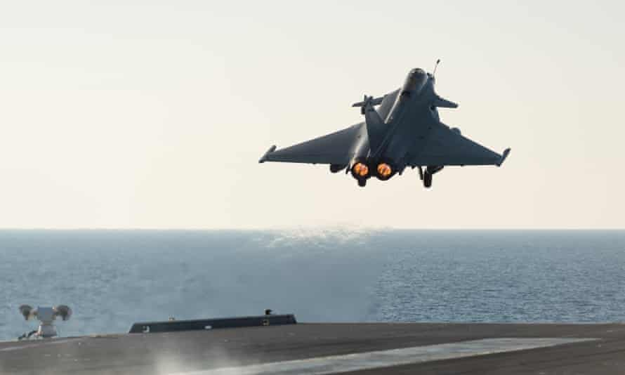 A French army Rafale fighter jet takes off from the aircraft carrier Charles de Gaulle, in the Mediterranean sea.