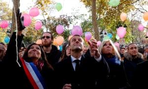 Anne Hidalgo, Emmanuel Macron and his wife, Brigitte, release balloons in Paris