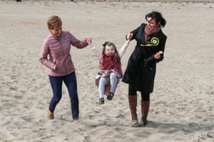 Ayr, Scotland. The first minister and leader of the Scottish National party, Nicola Sturgeon (left), plays with local candidate Siobhian Brown's daughter Scarlett, before campaigning for the parliamentary elections