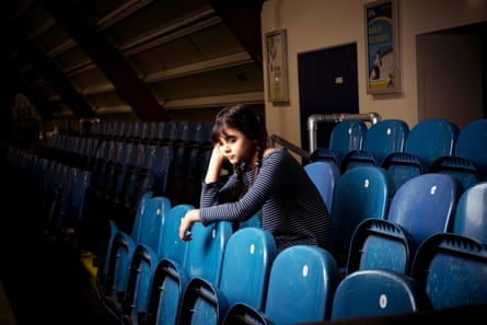 A tired young girl at a sports venue