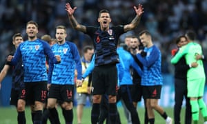 Dejan Lovren is at the centre of Croatia's celebrations after their 3-0 World Cup win over Argentina.
