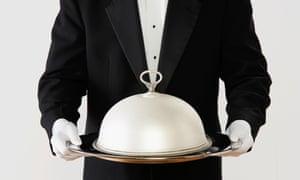 Waiter holding silver salver