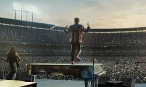Elton John playing a stadium concert in the ad