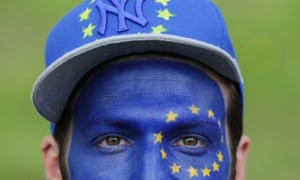A remain supporter with his face painted in the EU flag