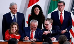 Mexico's President Andrés Manuel López Obrador looks on as Chrystia Freeland for Canada, Jesús Seade for Mexico, and Robert Lighthizer for the US sign the trade pact at the presidential palace, in Mexico City on 10 December.