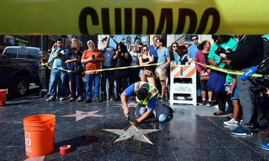 Donald Trump's vandalized star along the Hollywood walk of fame is tended to and cleaned up before being replaced.