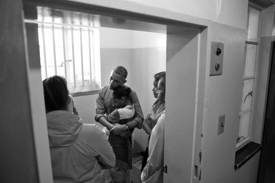 Obama hugs his daughter Sasha during a visit to Nelson Mandela's former prison cell on Robben Island in Cape Town, South Africa