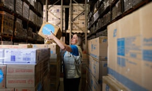 Felicity Wever, director of international programs at Unicef Australia, with some of the personal protective equipment being sent to Timor Leste.