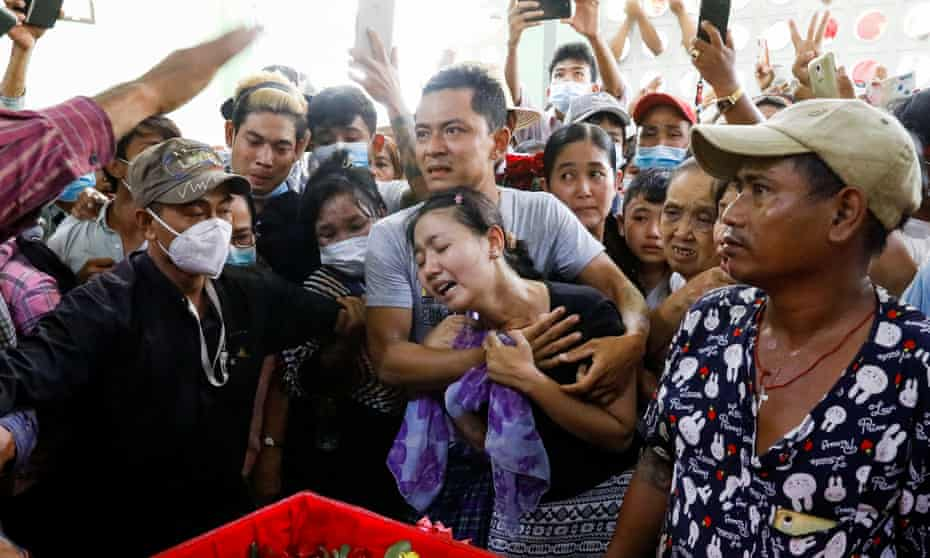 Family members attend the funeral in Yangon of Zaw Myat Linn, a member of Myanmar's pro-democracy opposition.