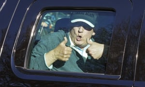 Donald Trump gives two thumbs up to supporters as he departs after playing golf at the Trump National Golf Club in Sterling, Virginia