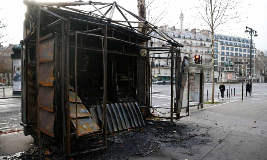 A burned out newsstand in Paris on Sunday, the day after clashes during a national day of protest by the gilets jaunes