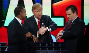 Republican presidential candidates Ben Carson, Donald Trump and U.S. Sen. Ted Cruz (R-TX) look at their watches during the CNN Republican presidential debate on December 15, 2015 in Las Vegas, Nevada, perhaps wondering when they will be asked about climate change.