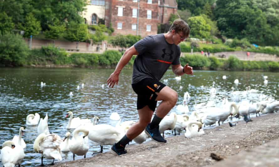 Ted Hill, the Worcester Warriors flank forward, works out on the banks of the River Severn in May.