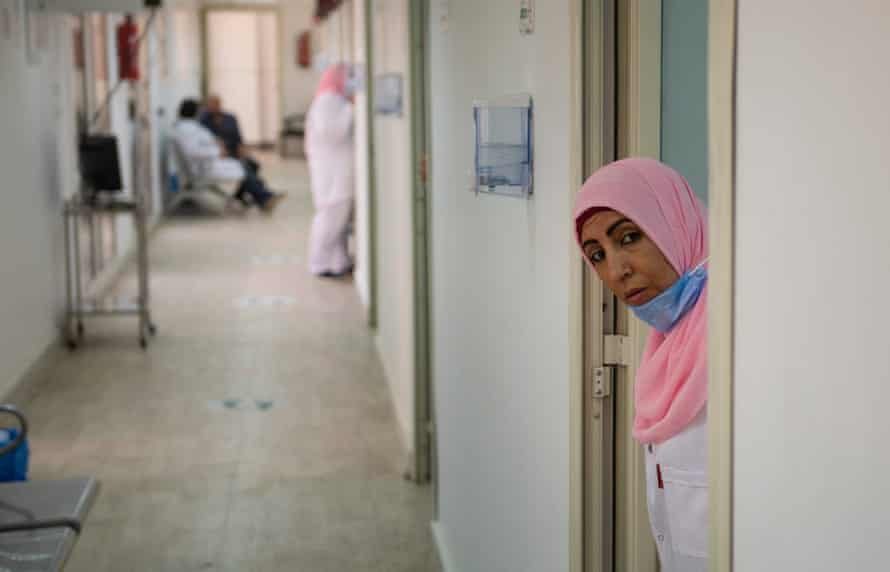 A nurse awaits volunteers for clinical trials of a coronavirus vaccine in Cairo, on 14 September.