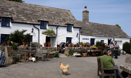 Square and Compass Village Pub with people and chickens outside, Worth Matravers, Dorset, England, UK
