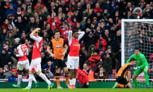 Arsenal's Alex Iwobi, centre, reacts with team-mates and fans as he rues a missed chance.