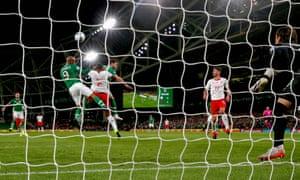 Republic of Ireland's David McGoldrick scores their equaliser.