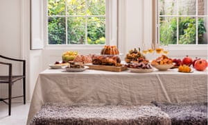 Table laden with Nigel Slater's Christmas dinner and treats