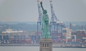 Park police negotiate with a protester who climbed the pedestal of the the Statue of Liberty in New York on Wednesday
