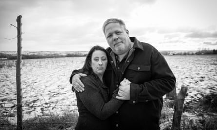 Nacole and Tom, parents of JS, standing in a snowy field