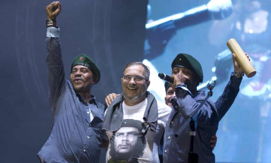 Rodrigo Londoño, AKA Timochenko, the top leader of the Farc, is embraced by singers of the Southern Rebels guerrilla band during the concert.