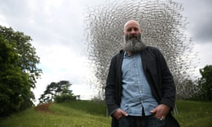 Artist Wolfgang Buttress poses with his sculpture