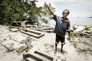 James standing in the village cemetery that is in danger of being washed away.