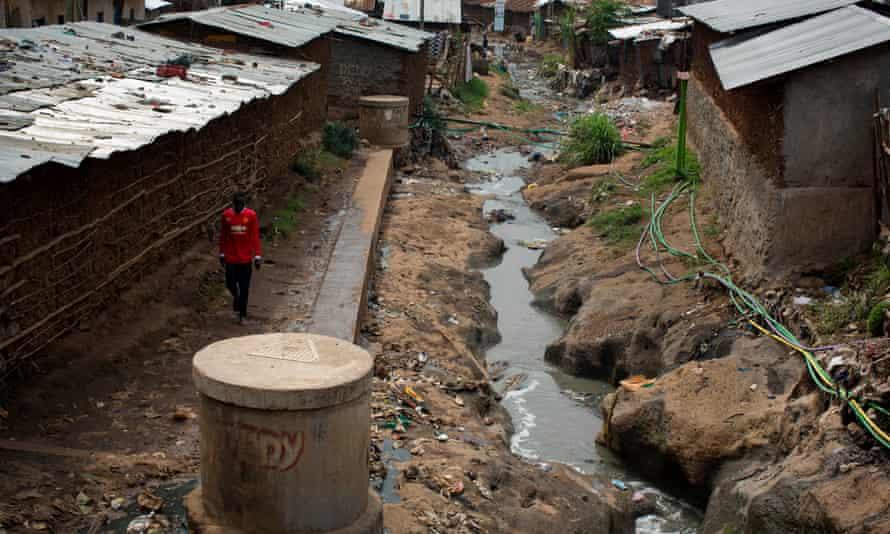 A man walks past a spot in Kibera where a dead baby was left
