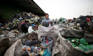 A waste picker sifts through trash in the neighbourhood of Jose Leon Suarez, on the outskirts of Buenos Aires