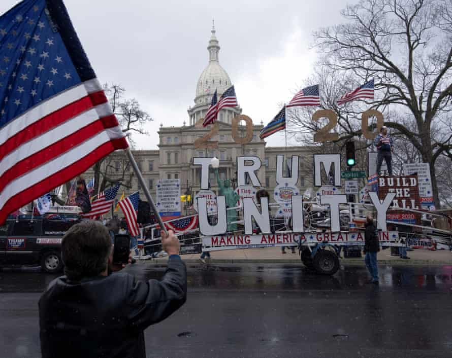 Protesters against the state's extended stay-at-home order demonstrate in Lansing, Michigan in April.