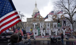 Trump supporters protest against the lockdown outside the state capitol in Lansing, Michigan.