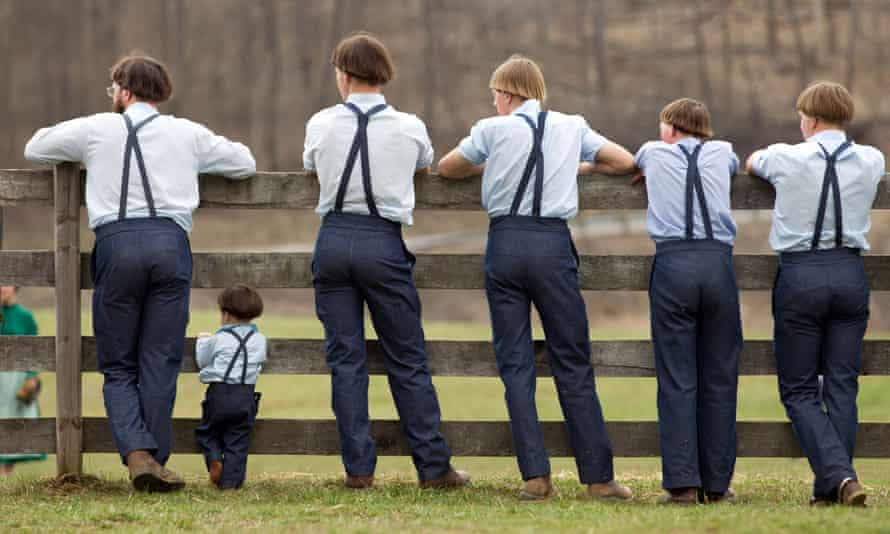 Amish boys watch a game of baseball. In the population studied, those with the mutation were found to have better metabolic health, far less diabetes, and tended to live a decade longer than others without the mutation.