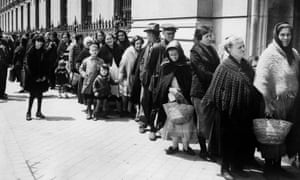 Spanish citizens queue up for bread handouts in Madrid, 1933.