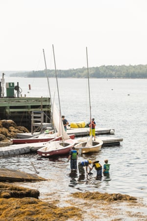 Students work together to prepare for a sailing adventure at the Sailing Academy at the Shelburne Harbour Yacht Club & Marina.