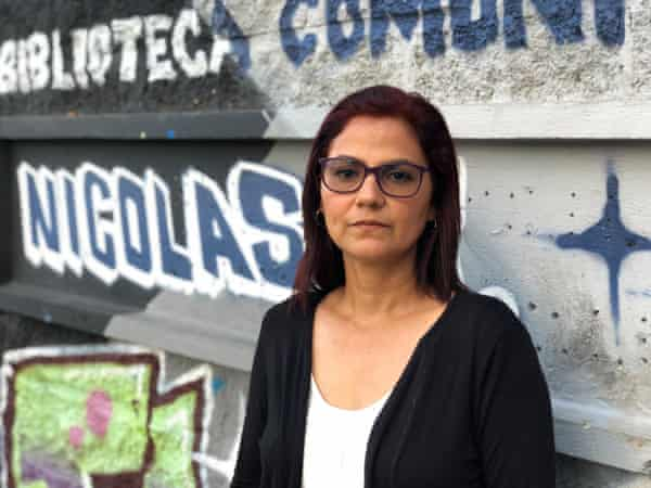Laura Guerrero in front of graffiti bearing her son's name.