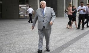 Clive Palmer leaves the supreme court in Brisbane, Friday, 26 April, 2019.