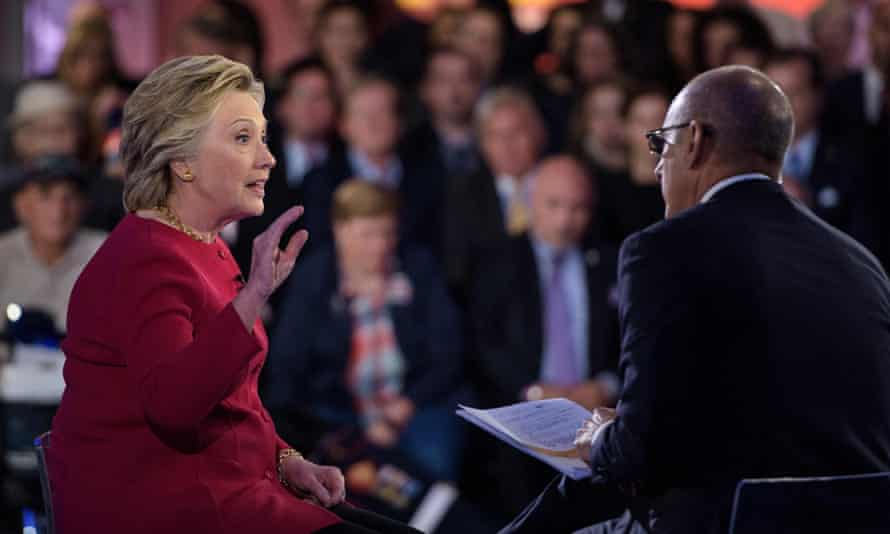 """Matt Lauer (R), co-host of """"The Today Show,"""" listens as Democratic presidential nominee Hillary Clinton answers a question during a veterans forum aboard the aircraft carrier USS Intrepid September 7, 2016 in New York, New York. / AFP PHOTO / Brendan SmialowskiBRENDAN SMIALOWSKI/AFP/Getty Images"""