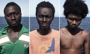 Enssa (17), from Senegal, Ousman (17), from Guinea-Conakry and Alpha (18), from Guinea-Conakry pose for a portraits minutes after being rescued on the Mediterranean Sea.